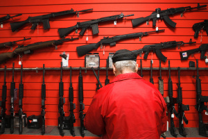 A customer browses the selection of assault rifles at Frontier Guns and Ammo in Evergreen.