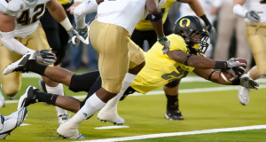 Oregon running back LaMichael James gets the Duck's first score as he dives in the end zone for a touchdown early in the first quarter against the UCLA Bruins at Autzen Stadium in Eugene, Ore.