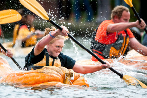 Contestants race in the 7th Annual West Coast Giant Pumpkin Regatta held at the Lake of the Tualatin Commons in Tualatin, Ore.