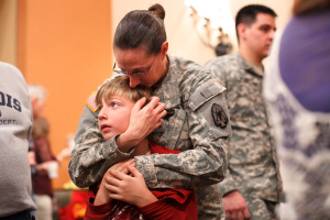 Sgt. Aimee Schmidt embraces her son Colton, 8, after the deployment ceremony for the Montana National Guard's 495th Combat Sustainment Support Battalion at the Hilton Garden Inn in Kalispell, Mont.
