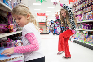 Sophia Smith, right, and Arvilene Pearson react to knocking toys off the shelf at Target during the 9th annual Shop with a Cop put on by the Columbia Falls Police Department. Seven children were paired with members of the Columbia Falls Police department to select gifts for the children and their immediate family members paid for with community donations and gift cards sponsored by Target. The families selected also received a $25 gift certificate to Super 1 foods in Columbia Falls, Mont.